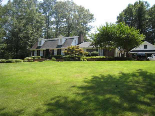 This Vinings home for sale features beautiful, lush landscaping. Listed by Tina Hunsicker.