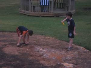 Muddy boys playing in the rain at The Cochise Club in Vinings.