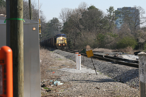 A switch from coal-burning to natural gas powered at the nearby Plant McDonough may mean a 38% reduction in trains rolling through Vinings on a daily basis....during the year 2012! Photo by Flickr user Bartlett2.