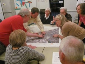 Vinings residents pore over a map of their community at the second meeting of the Vinings Vision Plan. Credit Hunt Archbold.