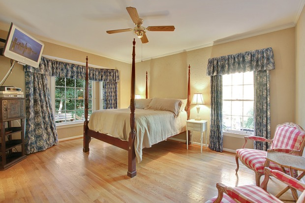 The spacious master bedroom is on the main level, with three additional bedrooms upstairs. Click on the image for more photos and information about this Vinings home for sale.