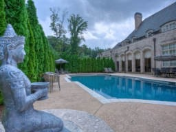 A placid, walk-out pool from the main level is the perfect accessory to this beautiful home in Buckhead.