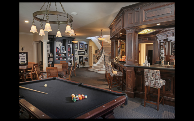 An incredible game room complete with bar, pool table, tvs, and access to the theatre room, stage and recording studio.