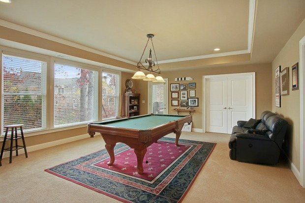 A game room is on the terrace level, which opens to the wooded lot.  Also on the terrace level is a full bath and room for another bedroom.