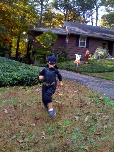 "An action shot of my son, Chase, after ""Booing"" a neighbor's house.  He loves it!"
