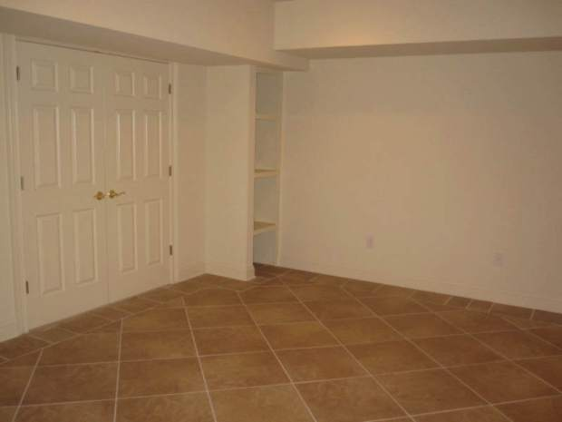 A tile floor was installed in this post-flood home that is under contract in Vinings. Very practical!