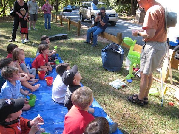 An entertainer making balloon animals and performing magic tricks is always a hit with the kids!