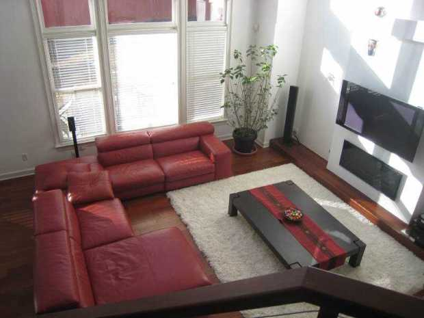 The living room is airy and features dark hardwood floors.  Please click on the image for additional information and photos.