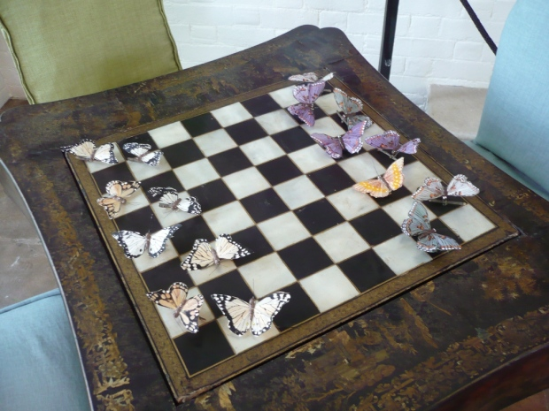 Butterflies (not real) are used in place of chess pieces on this antique Chinoiserie games table from Parc Monceau. Photos from The Peak of Chic.