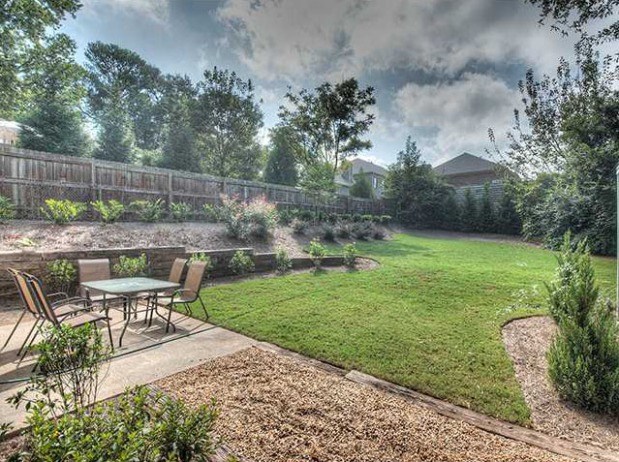 The level backyard is professionally landscaped and features a patio for dining alfresco. Click on the image for more photos and information from my website.