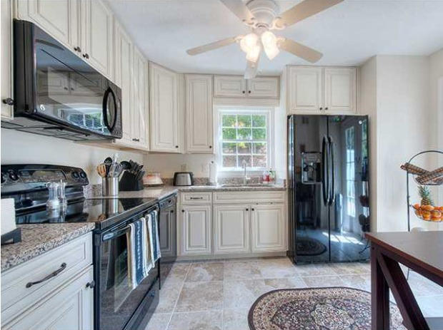 The kitchen features tile floors, beautiful cabinetry, granite countertops, and all new appliances.  Click on the image for more photos and information from my website.