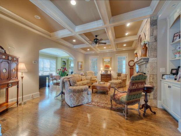 The living room's elegance is defined in the ceiling. The open floorplan, perfect for entertaining, is epitomized in this flexible space.
