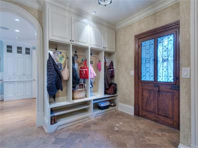 Ultimate functionality and thoughtfulness is found in this mudroom with personal storage areas for everything from shoes to coats to sports gear to dog leashes to....you name it!  Click on the image for additional photos and information.