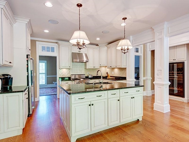A beautiful kitchen that is open to all the main areas of the home.