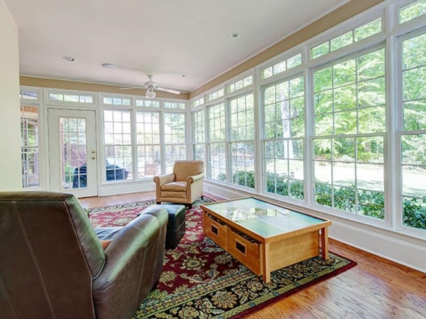 What a beautiful sun room - just off the kitchen, and overlooking the private backyard.
