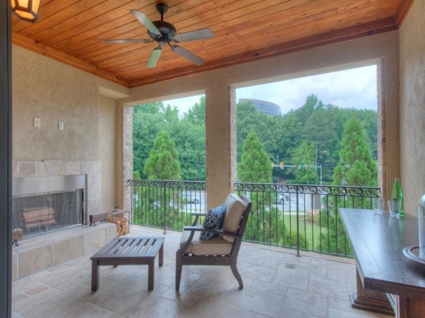 An outdoor patio features its own fireplace which makes for the perfect outdoor room.
