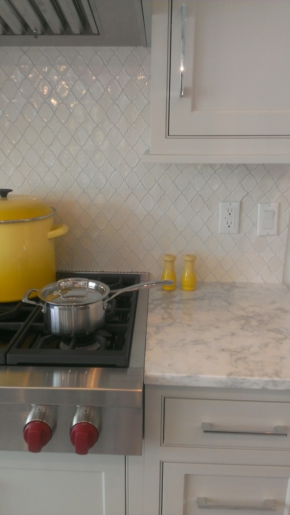 Even better....look at the detail of the kitchen's marble, tile and cabinetry color.  Love it!