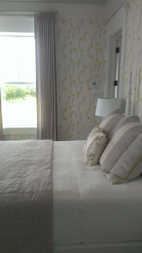 A guest bedroom in the Coast Living 2013 Showhouse in Daniel Island in Charleston. I love the use of grey's and yellows. The linen fabrics needed to be touched as well. So inviting!