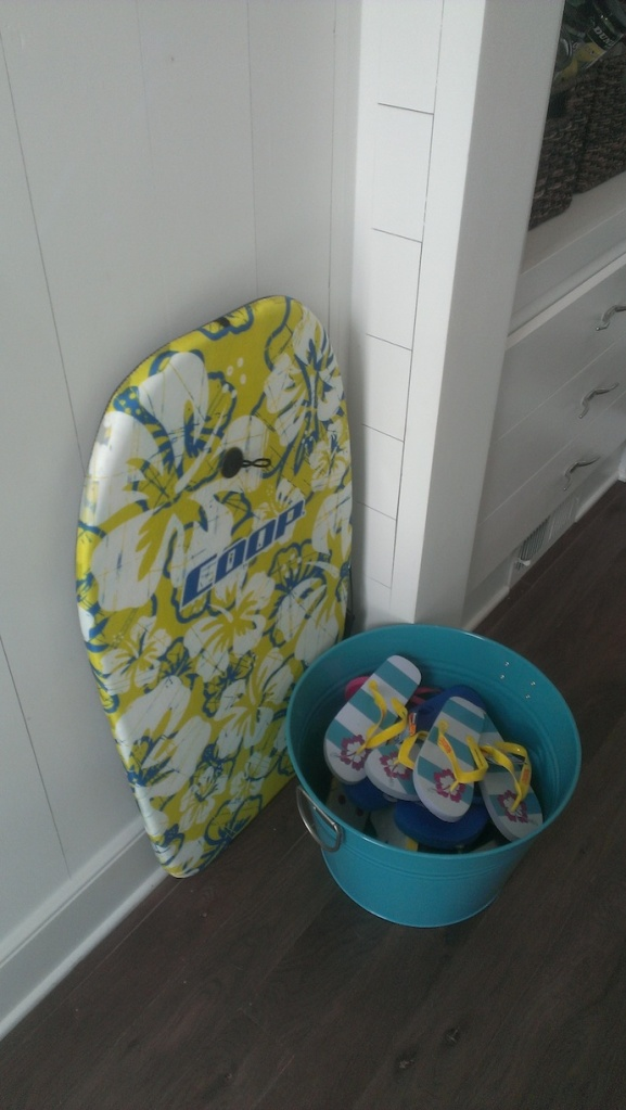 In the wonderful back hallway leading to the garage are lockers filled with towels and beach gear.  I loved the idea of the bucket for the flip flops.  We need this at my house!