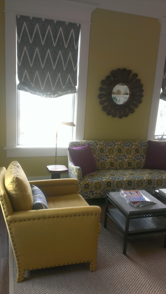 The formal living room has many bold colors. Love the print on the sofa!