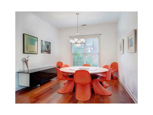 The dining room at 1912 New Haven Court is also modern - note the light color palate with an intentional splash of color.  Wonderful!  Click on the image for additional information and more photos.