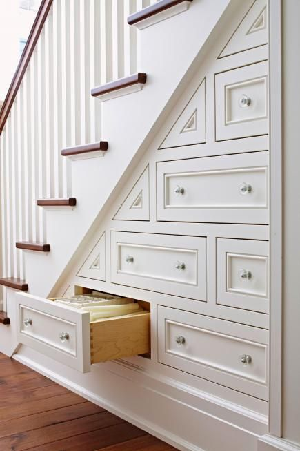 Great built-in drawers for using space under the stairs for storage. photo credit: midwestliving.com