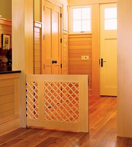 Pocket gates keep babies safe around stairs and help contain pets in certain areas of the house. photo credit: atticmag.com