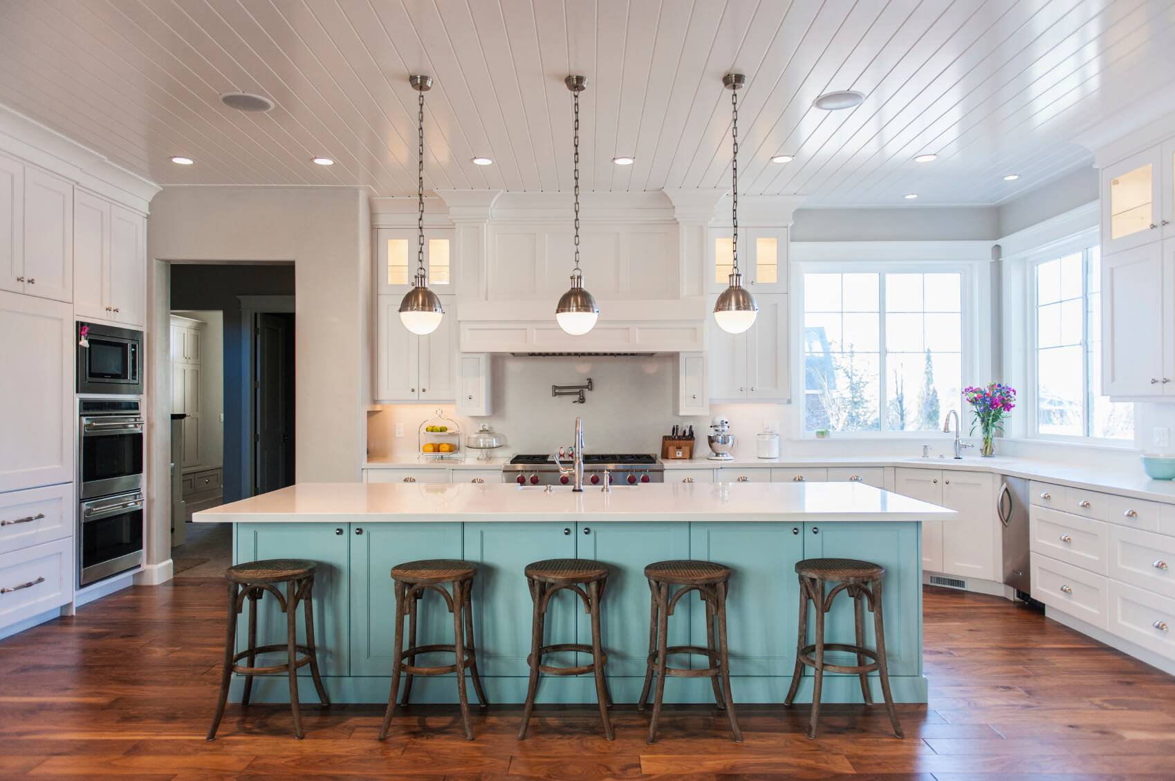 extra-kitchen-counter-space-ideas_cabinet-color-palettes_pendant-light-over-island_kitchen-island-design-with-stove_faucet-satin-nickel-finish.jpg
